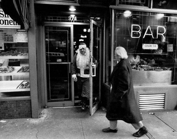 Bruce Gilden, New York City. 1968. Santa leaving bar.