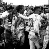 Burt Glinn, USA. Seattle, Washington. 1955. The head cheerleader and the football captain embrace after a game. Their team had just won a game for the first time in three years.