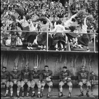 USA. 1955. High school football and cheerleaders. art for sale