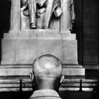 Burt Glinn, USA. Washington, D.C. 1959. Nikita Khrushchev in front of the Lincoln Memorial.