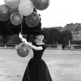 Paris. 1st arrondissement. Jardins des Tuileries. Dutch actress Audrey Hepburn. 1956., by David Seymour