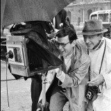 David Seymour,  Paris. The Tuileries Gardens. Richard Avedon, fashion photographer and technical director, advising Fred Astaire on his role as a photographer.