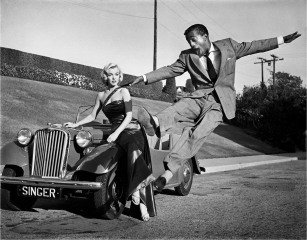 "Sammy Davis, Jr. leaps for Marilyn Monroe on set of ""How to Marry a Millionaire"" , by Frank Worth"