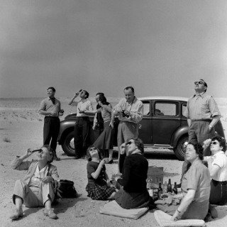 Total Eclipse of the Sun. Kuwaiti Oil Company personel and their families bring a picnic lunch to the desert to watch the eclipse. 1952. art for sale