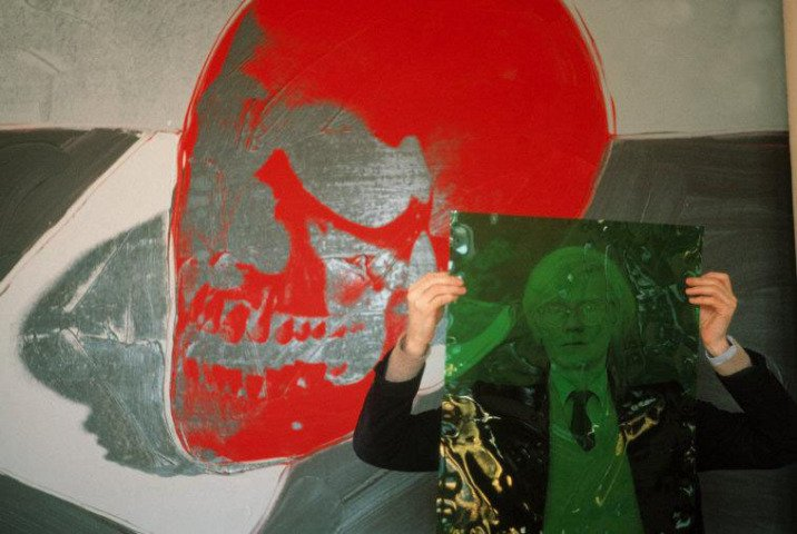 "Thomas Hoepker, New York City. 1981. Andy Warhol with a skull painting in his ""Factory"" at Union Square."